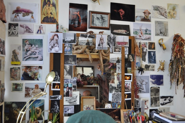 A mirror surrounded by images in Moran Sanderovich's studio, February 2020  Photography: Michal B. Ron