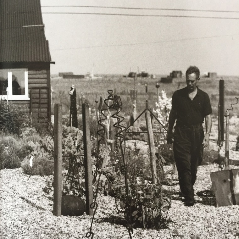 Derek Jarman in the garden at his cottage, in Dungeness. Photography: Howard Sooley