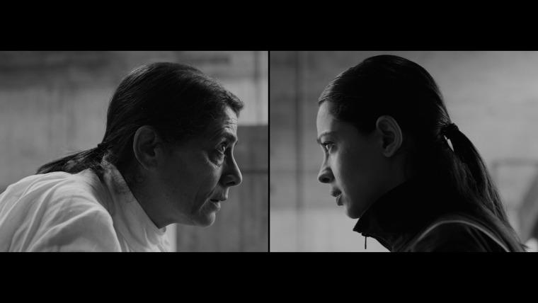 לריסה סנסור וסורין לינד, במבחנה, סרט דו-ערוצי בשחור לבן, 27 דקות ו-44 שניות, 2019. באדיבות האמנית