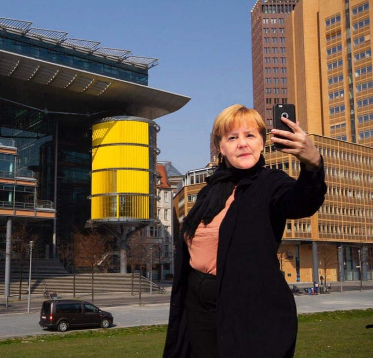 """""""Busy day for our amazing leader.""""  In the photograph: Merav Maroody with an Angela Merkel mask. March 23, 2020"""