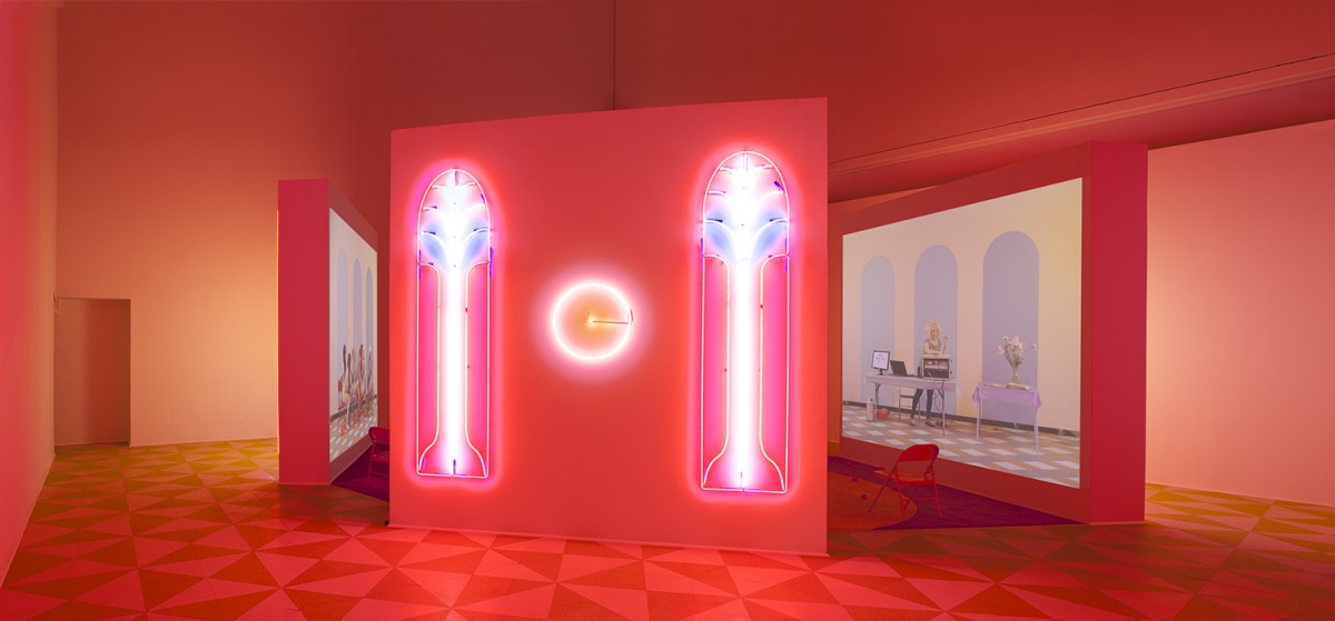 Alex Da Corte (b. 1980) and Jayson Musson (b. 1977). Easternsports, 2014. Four-channel video, color, sound; 152 min., with four screens, neon, carpet, vinyl composition tile, metal folding chairs, artificial oranges, orange scent, and diffusers. Score by