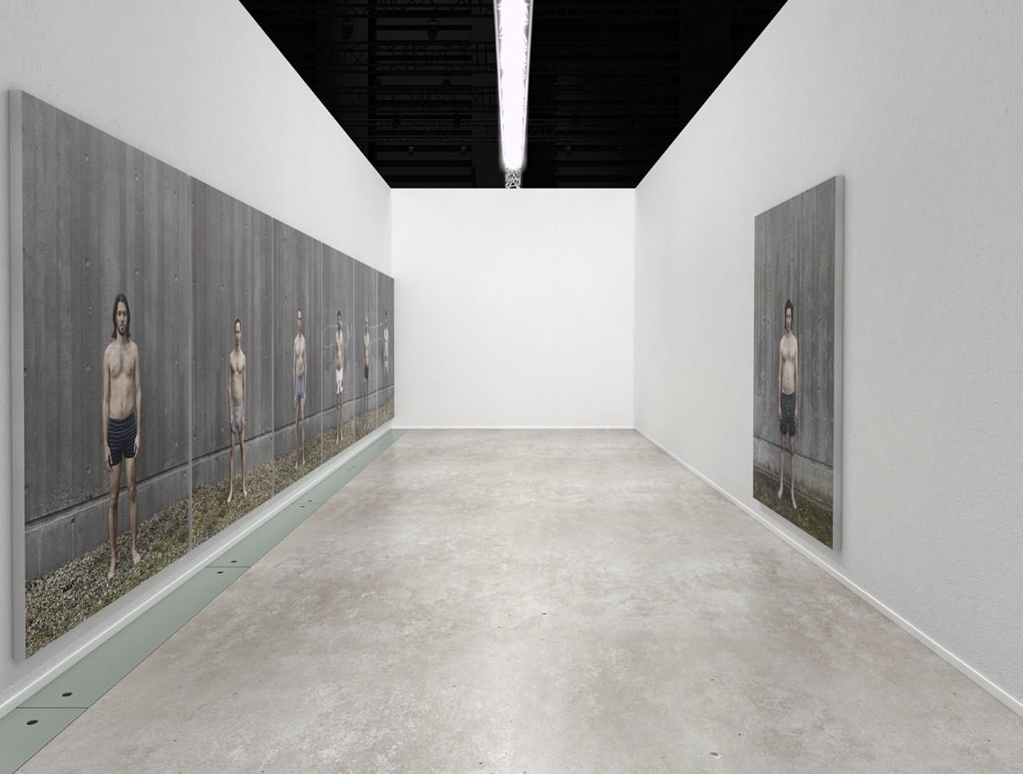 Steve Sabella, Settlement - Six Israelis & One Palestinian, 2008 / 2010. Installation of life size images. The image of the Palestinian faces the six Israelis. That is, the work hangs on two opposite facing walls. 230 cm / 164 cm each mounted on aluminum